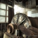 Tumber - Gold mining equipment lies open to the weather and rusting