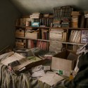 A Good Read - Stacks of books take up every possible space at an abandoned home on eastern plains of Colorado.