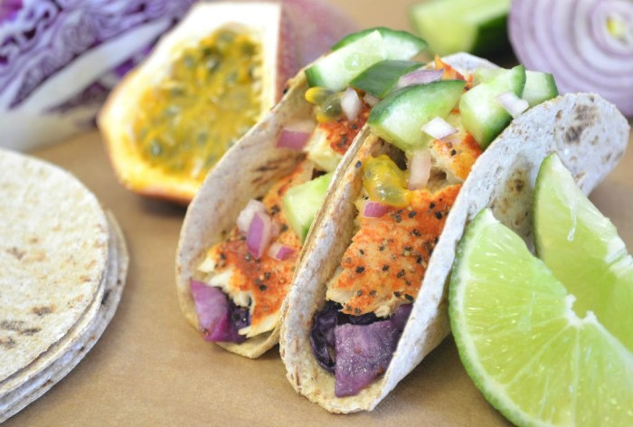 Fish Taco with roasted red cabbage and topped with a passion fruit salsa.
