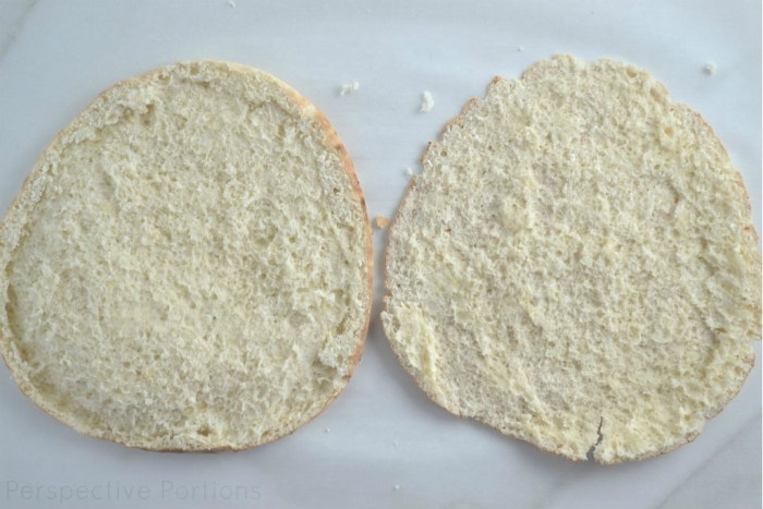 Cut pita bread in half to create a no knead pita pizza dough.