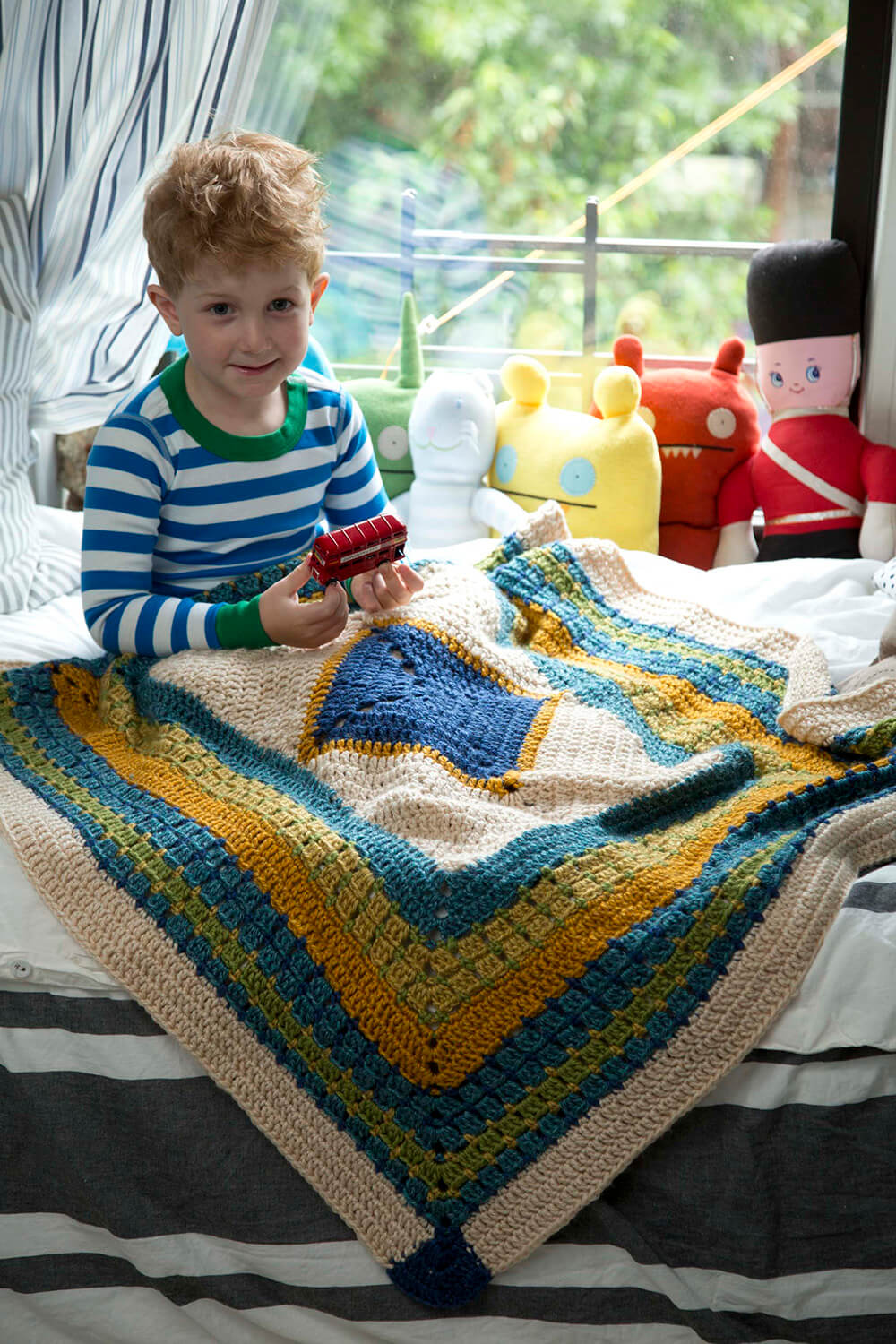 The Lion Brand Little Boy Blue Blanket Crochet Pattern is full of fun stitch work and color opportunities!!