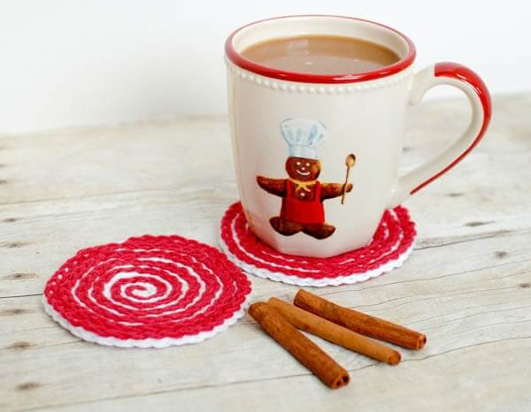 These Peppermint Swirl Crochet Coasters are perfect for adding holiday charm to your home or for gifting. Work up a set and pair it with some gourmet hot chocolate mix and marshmallows and you have a great gift set! www.petalstopicots.com #crochet #pattern #Christmas #holiday