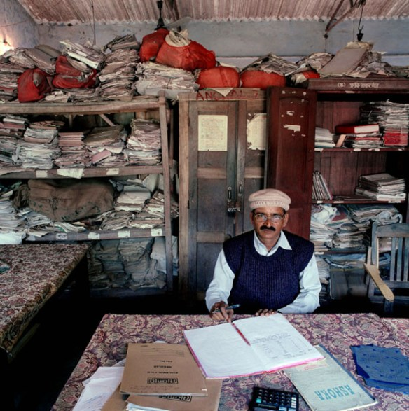 "India, bureaucracy, Bihar, 2003. India-19/2003 [Tha, SKM (b. 1946)]. Surinder Kumar Mandal (b. 1946) is circle inspector of taxes in Thakurganj block, collecting taxes in a specific part of Kishanganj district, State of Bihar. Monthly salary: 9,500 rupees ($ 208, 189 euro). Surinder Kumar Mandal (b. 1946) is ""circle inspector"" van belastingen in Thakurganj Block, Kishanganj district, State of Bihar. Maandsalaris: 9,500 rupees (euro 189, US$ 208)."