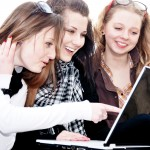 Three teenage girls with laptop