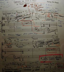 The first page of my performing score of 'Capriccio'-layers of technical work, conversations with the composer, and (in blue) observations of the pioneering performance by my teacher, Ralph Holmes.