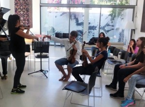 Working on Mozart Concerto K216 with two vioinists from Nikosia