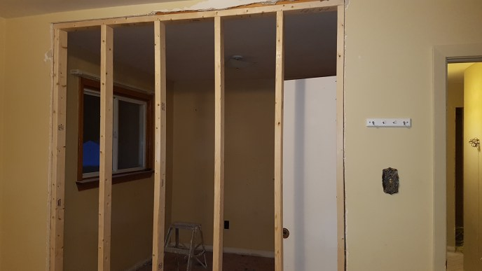 New wall to make one bedroom into two is framed