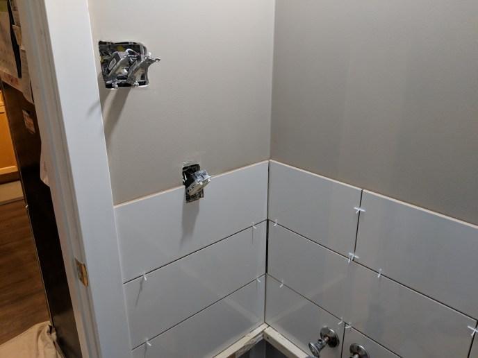 Small bathroom reno, tiles setting