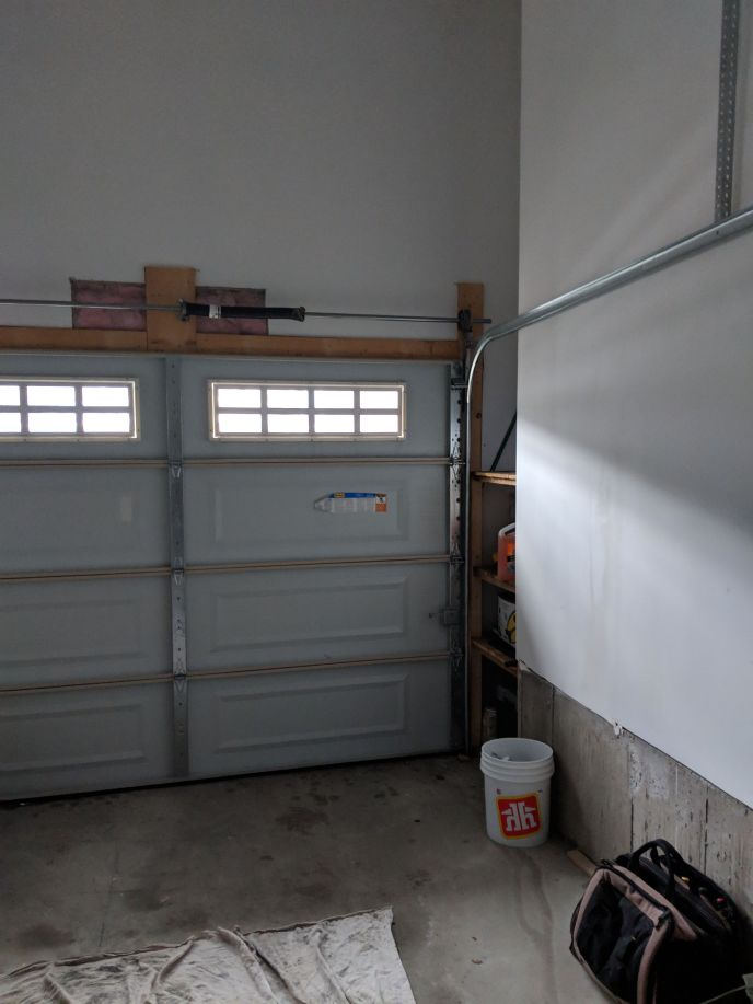 Garage door before new direct drive door opener installation