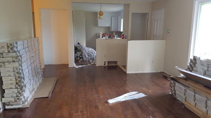 New floors in living room, half walls, and two new closets built