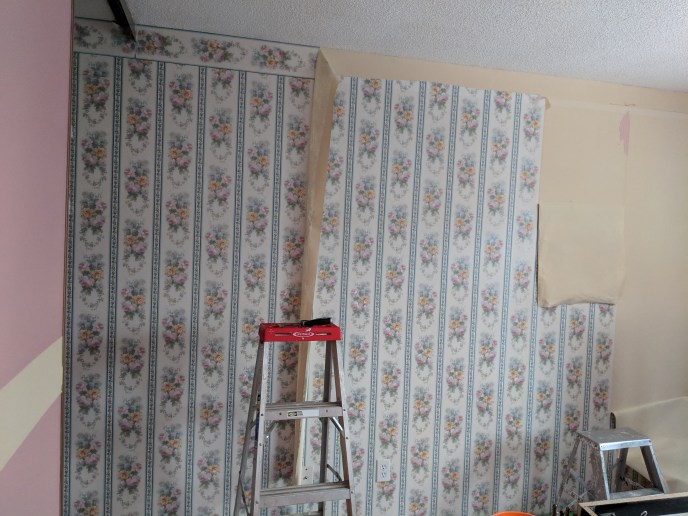 Wallpaper in the process of being removed