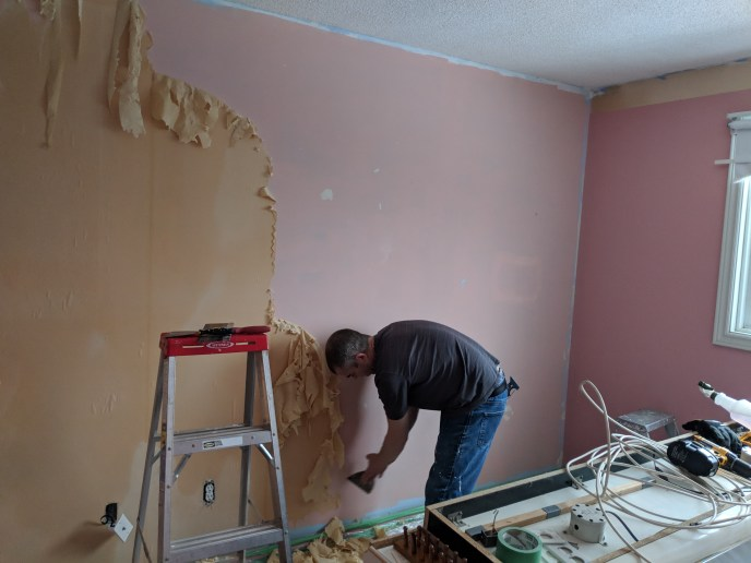 Second layer of wallpaper being removed