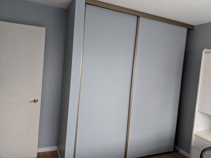 Closet doors painted after wallpaper border has been removed