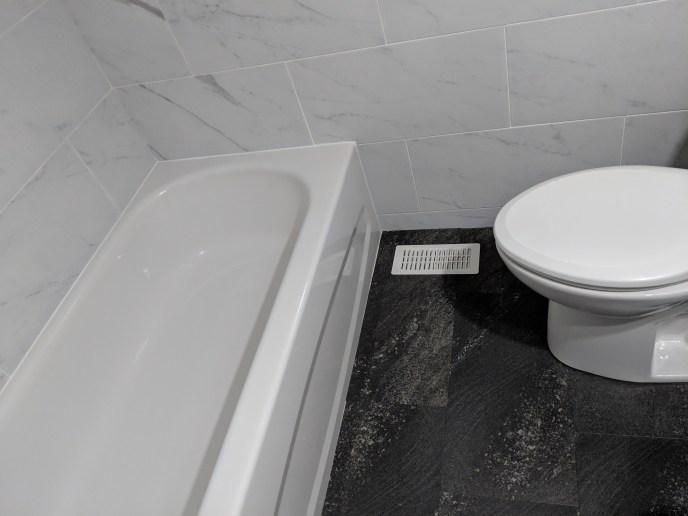 Bathroom reno, new tub, tiles, and flooring