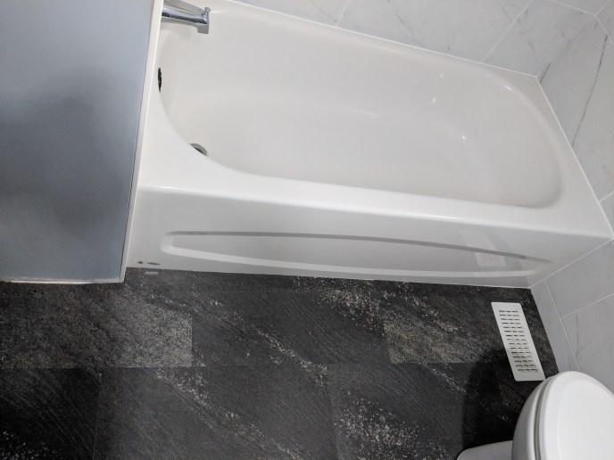 Bathroom reno, new tub and flooring installed