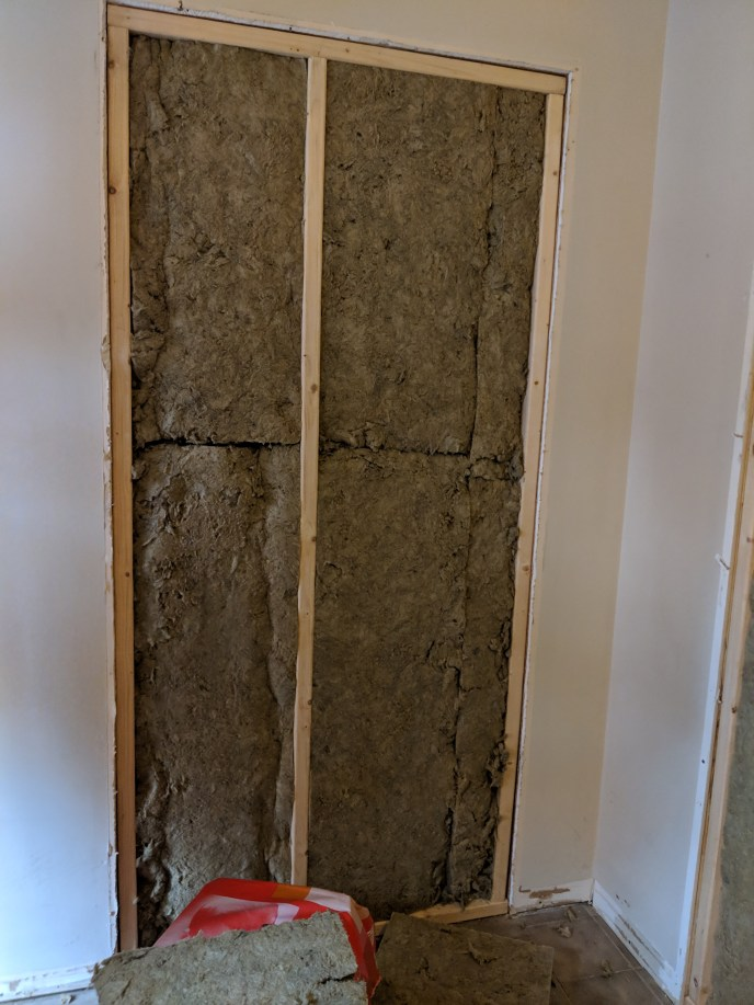 Doorway insulated before becoming a sound proof wall