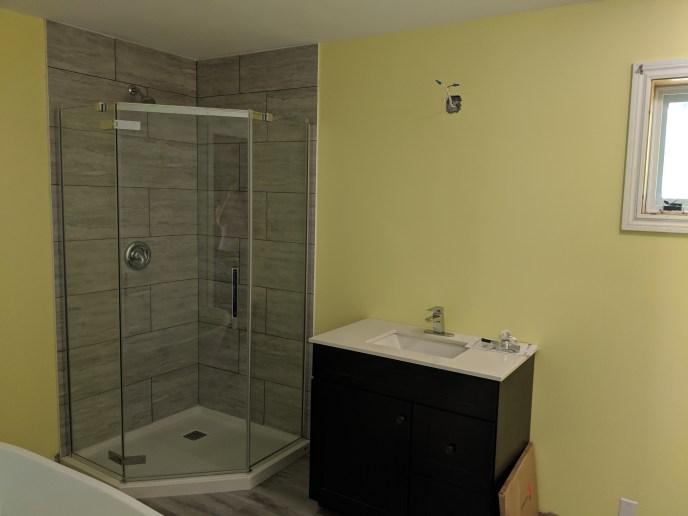 New shower, vanity, tub and floors installed in enlarged bathroom