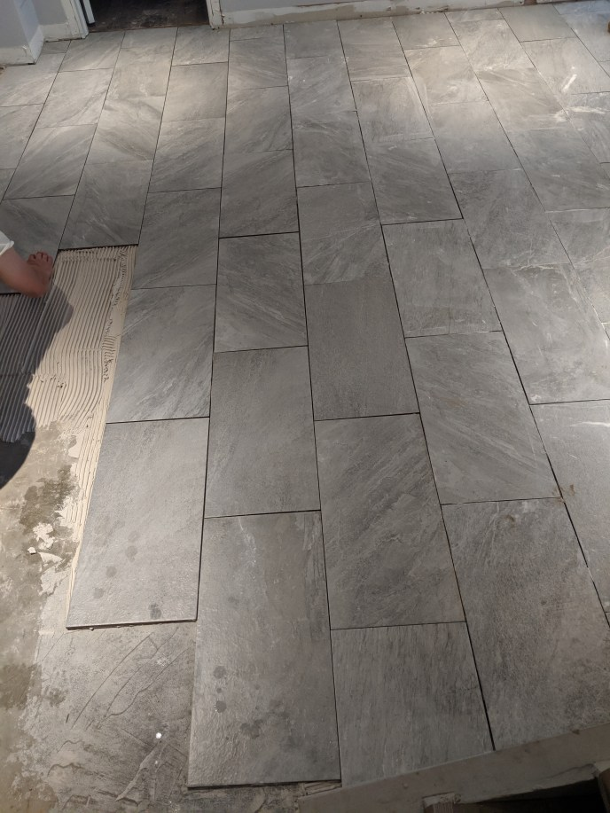 Tile floor in the process of being installed