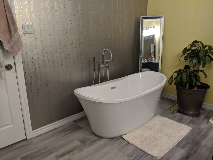 New stand alone tub installed in bathroom
