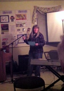 Susan reads poetry at Open Mic