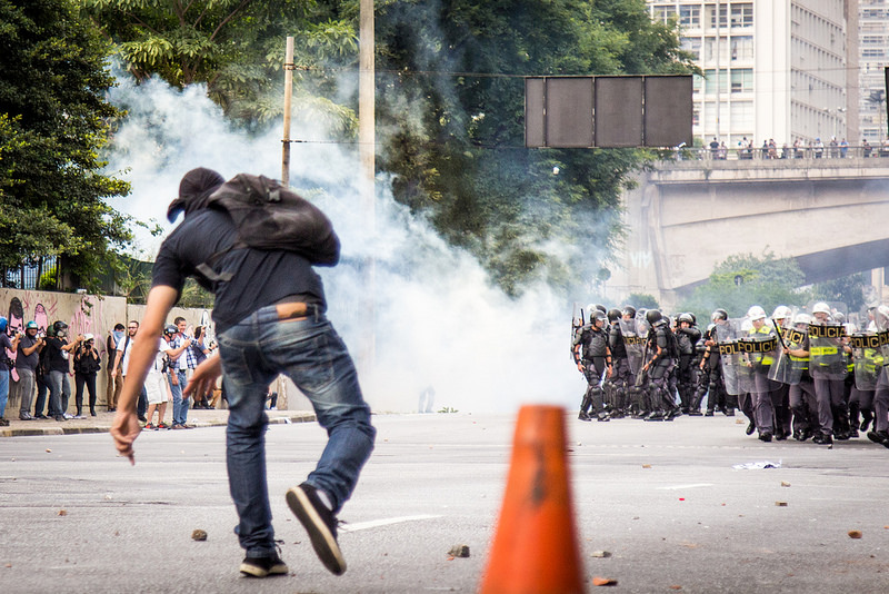 Picture of a rioter hurling rocks