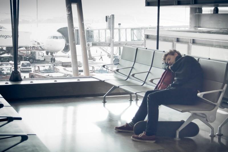 Man sleeping heavily at the airport