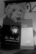 A book, a book, a spokesbear, a bed