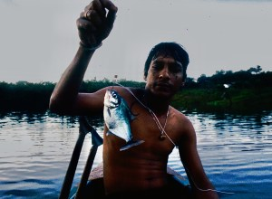 Daniel with a piranha in the Amazon