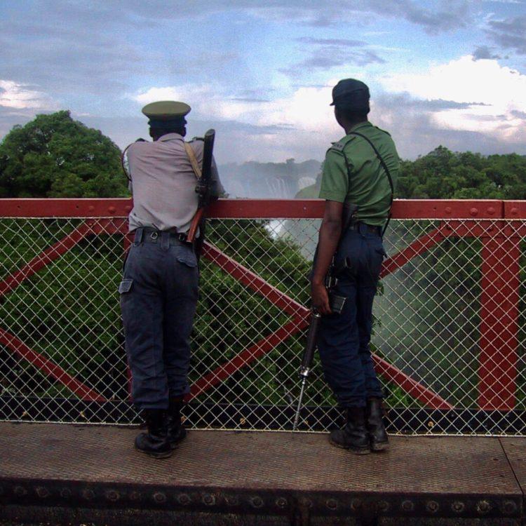 Guards looking towards Vic Falls on the Zimbabwe/Zambia border