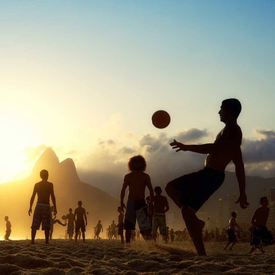 Football at sunset on Copacabana Beach (Adobe Stock)