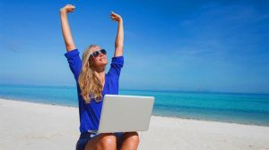 woman on beach earning passive income
