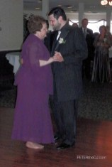 Dan dances with his mother.