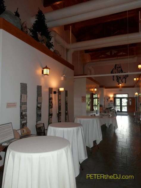 Cocktail hour tables and buffet line outside of the main room.