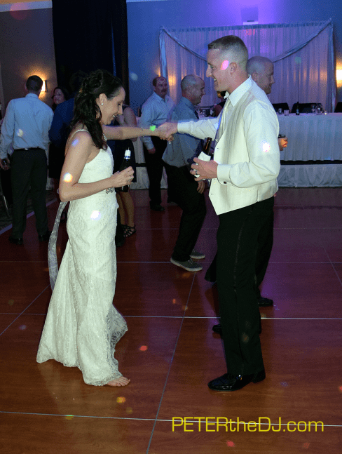 Bride and groom enjoy a dance together near the end of the night.