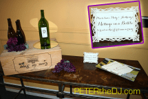 """Continuing the wine theme, guests were asked to leave a """"message in a bottle"""" for the newlyweds to read a year from now."""