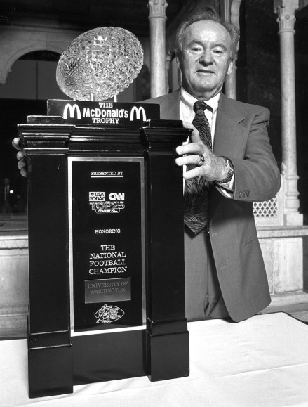 Coach James with the National Championship trophy.