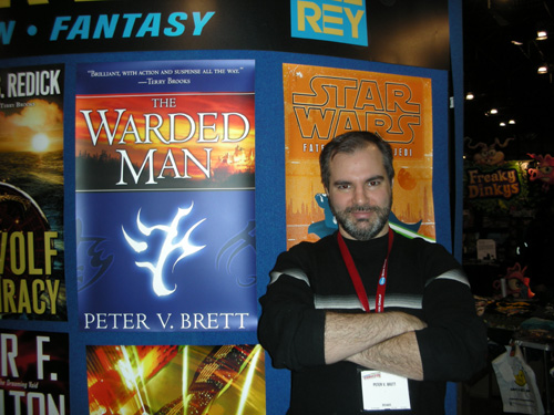 Peter posing in front of The Warded Man poster