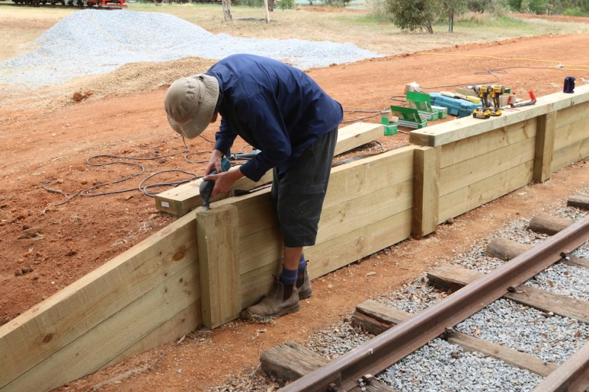 Image 2016.5054: The treated pine sleepers were certainly versatile! Here, Josh uses them for the platform edging. (Monday, 5th December 2016)