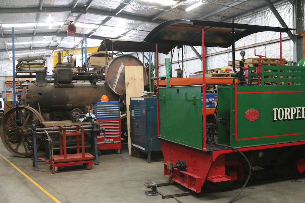 Image 2017.1913: My Hunslet shares space within Ainsworth Engineering's heritage workshop with a rather large traction engine.