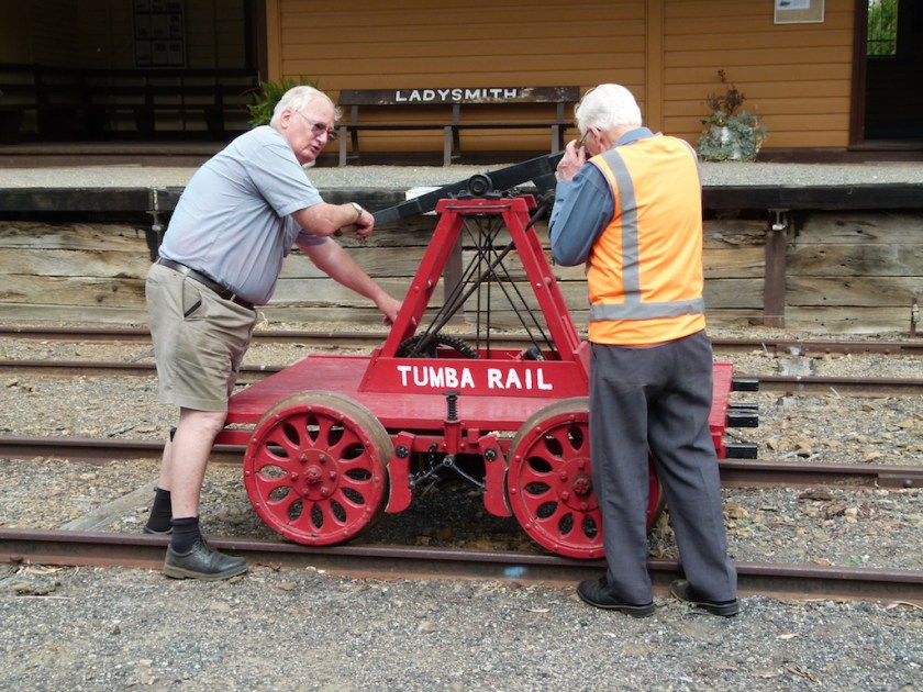 Image P1230477: Peter inspecting Tumba Rail's trike at Ladysmith Station