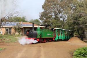 Fully restored 1915 Hunslet steam locomotive operating in the front yard of local Junee resident, Peter Neve.