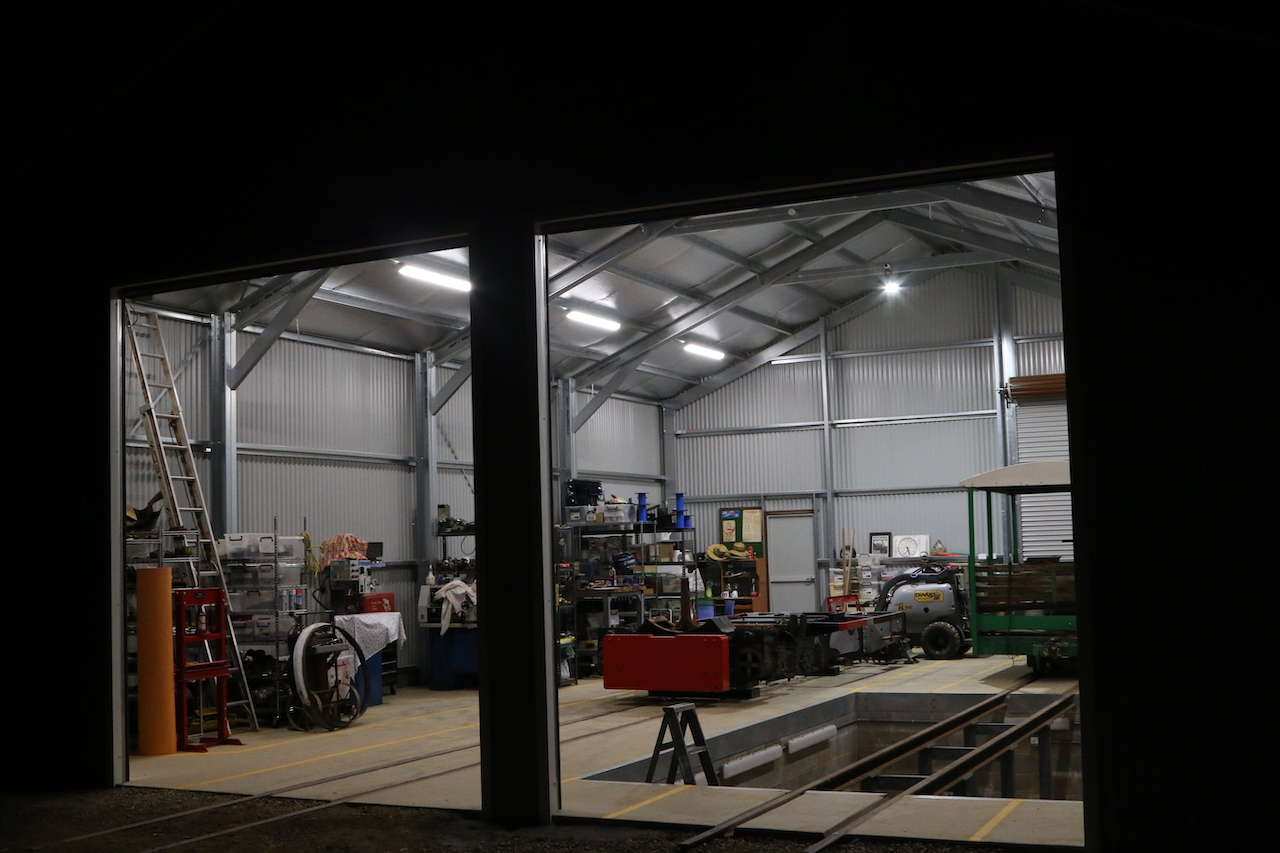 Image 2020.0629: Night scene showing interior lighting of Shed being tested. Fowler frame is elevated on 1 Road. To have had the pit lights on as well would have provided too much glare! Wednesday 15/4/2020.