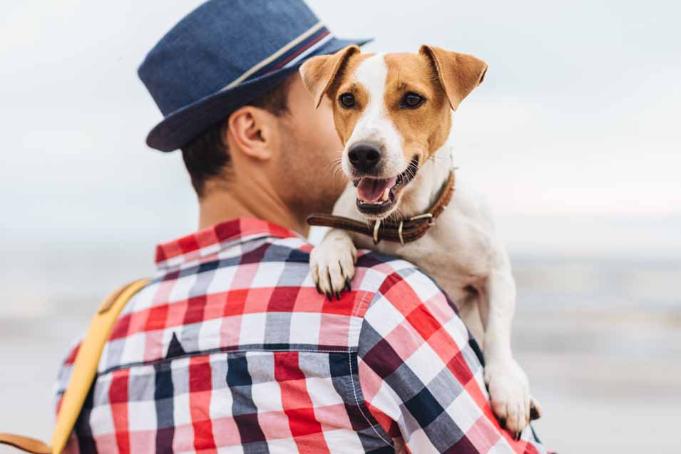 A picture of a man holding a dog