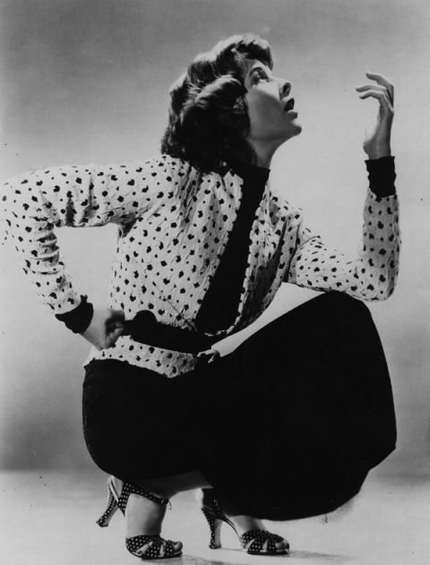 Katharine Hepburn in a cinched-waist blazer and black dress from 1930s.