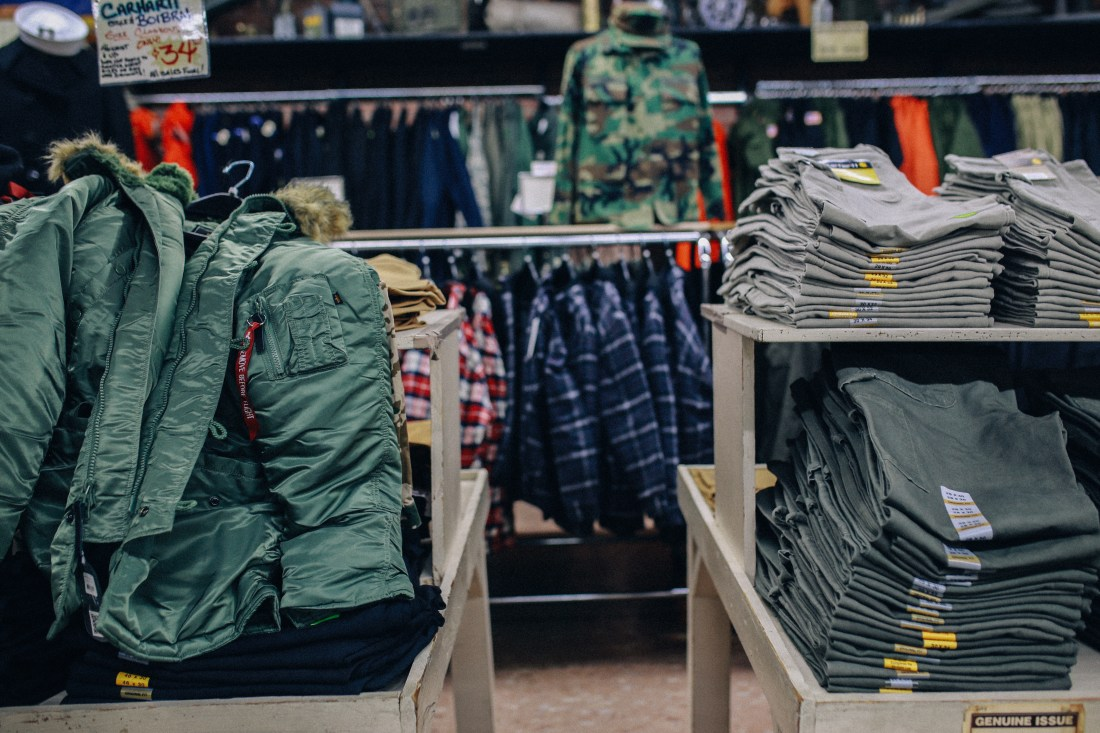 Jackets, pants, and flannel at Federal Army Navy Surplus in Seattle.