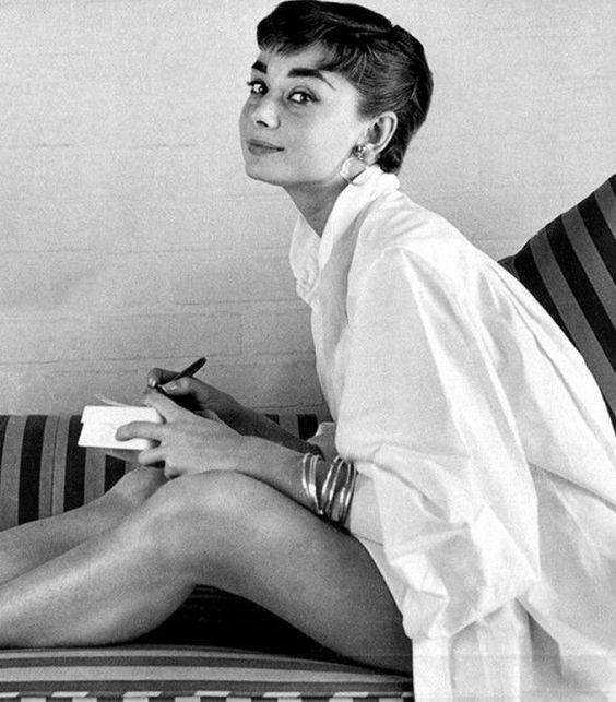 Audrey Hepburn white button-down shirt. Classic look.