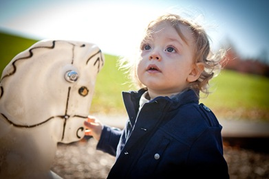 Boy playing with rocking horse at playground in Derwood Maryland