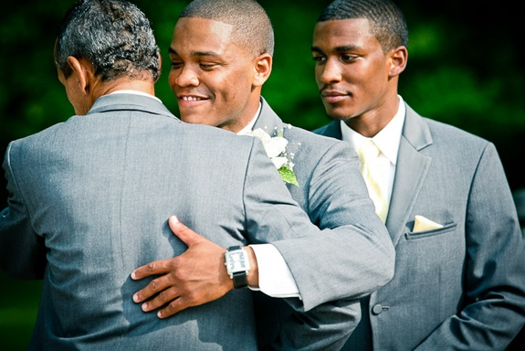 groom hugging father in law  at the Newton White Mansion in Mitchellville MD