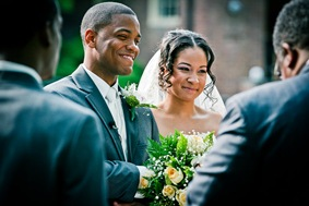 bride and groom at the alter  at the Newton White Mansion in Mitchellville MD