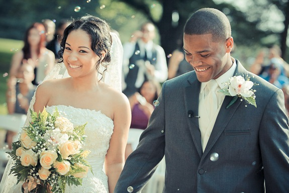 bride and groom walking down isle at the Newton White Mansion in Mitchellville MD